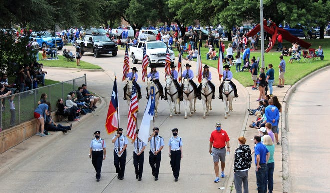 Not only did parade participants distance themselves, so did most of the attendees Saturday morning, when the annual West Texas Fair & Rodeo parade wound its way through downtown. Some participants, too, were masked up. Sept. 12 2020