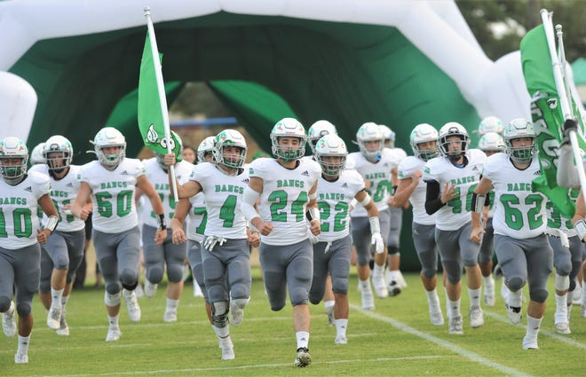 Bangs runs out onto the field before the Dragons' game against Winters. Bangs beat the Blizzards 42-19 in the nondistrict game Friday, Sept. 11 2020, at Blizzard Stadium.