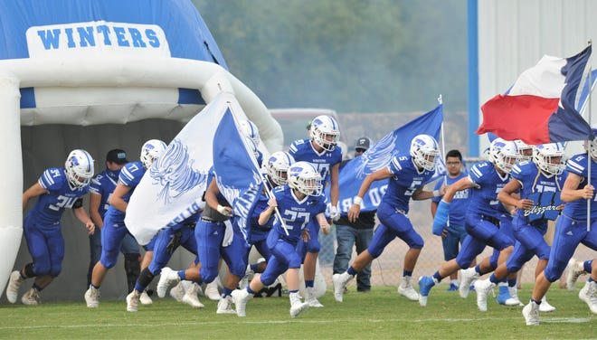 Winters players run out onto the field before the Blizzards game against Bangs. Bangs beat the Blizzards 42-19 in the nondistrict game Friday, Sept. 11 2020, at Blizzard Stadium.