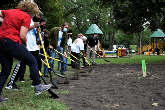 Members of the Neighborhood Planning Council No. 2 Claude Evans Splash Pad committee break ground on Saturday, Sept. 12, 2020 at Claude Evans Park.