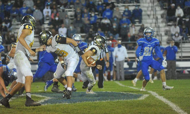 Colonel Crawford's Lincoln Mollenkopf rushed in the game-winning two-point conversion against Wynford.