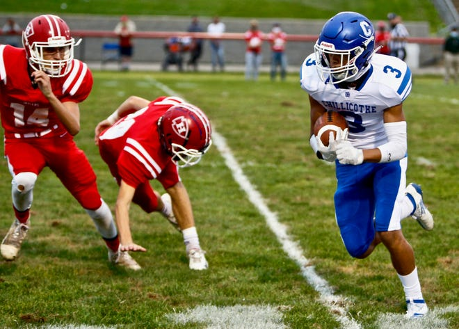 Chillicothe's Keyon Williams eludes defenders before finishing off a 23-yard touchdown reception in the first quarter to give the Cavaliers a 7-0 lead on Sept. 11, 2020. Chillicothe beat Hillsboro by a 41-14 final.