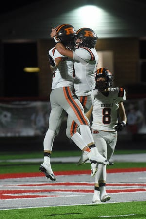 Dalton Patterson, left, is met in the end zone by quarterback Gabe Tingle after catching a 69-yard touchdown pass during the third quarter of Ridgewood's 42-7 win against Sandy Valley.