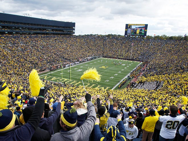 Fans cheer in the Big House for a game between Michigan and Michigan State in Ann Arbor, Saturday, Oct. 17, 2015.