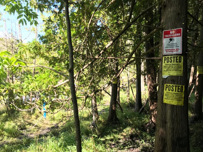 An image from the Michigan Department of Natural Resources shows trespassing signs they say are being violated during September fish runs in northwest Michigan.