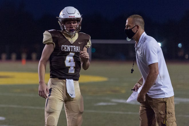 Central head coach Sean Coultis gives direction to Central's Blake Herdes (4) as the Central Bears host the Vincennes Lincoln Alices in Evansville, Ind., Friday evening, Sept. 11, 2020.