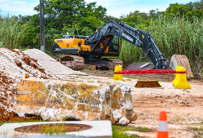 An excavator remains parked at a worksite, empty of workers, at Potts Junction in Dededo on Saturday, Sept 12, 2020.