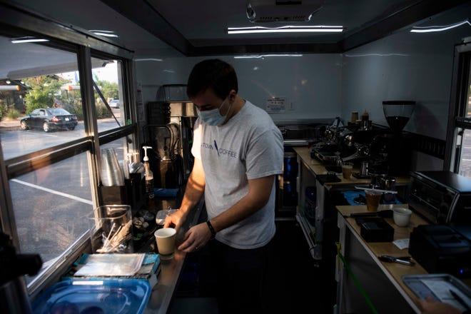 Nathan Ganucheau makes a beverage at J-town Coffee in Jackson, Tenn., near the Columns, Wednesday, Sept. 9, 2020.