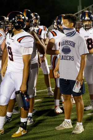 Harrison's Marcel Atisso, right, stands with the team during the fourth quarter of an IHSAA football game, Friday, Sept. 11, 2020 in Lafayette.
