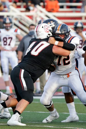 Harrison's Conor Munn (72) blocks Lafayette Jeff's Kayden Sowders (40) during the first quarter of an IHSAA football game, Friday, Sept. 11, 2020 in Lafayette.