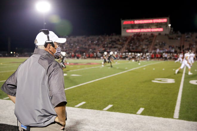 Harrison head coach Terry Peebles watches from the sidelines during the third quarter of an IHSAA football game, Friday, Sept. 11, 2020 in Lafayette.