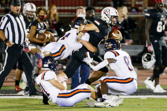 Harrison's Gavin Goodwin (21), Harrison's Levi Buck (34) and Harrison's Zion King (81) tackle Lafayette Jeff's Brady Preston (12) during the third quarter of an IHSAA football game, Friday, Sept. 11, 2020 in Lafayette.