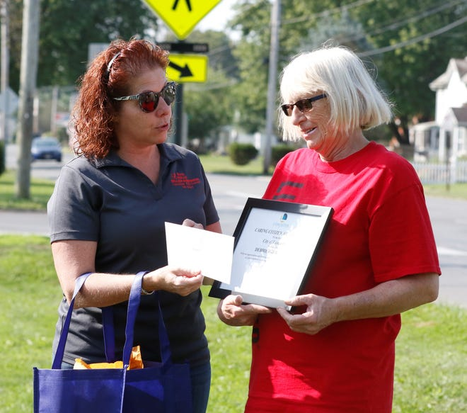 5th Ward Councilwoman Holly Miller-Downour, left, presents Debbie Probasco with the Caring Citizen award Saturday, Sept. 12. A member of the Southend Block Watch, Probasco is active in her neighborhood. She'll be one of three recipients of the Caring Citizen award from the Lancaster Community Development Department this year.