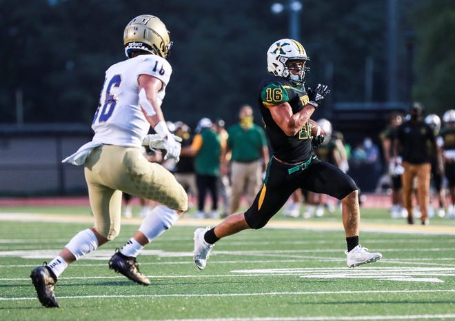 St. X's Grant Goodman runs for yardage against Bowling Green in the Tiger's season opener Friday night. Sept. 11, 2020