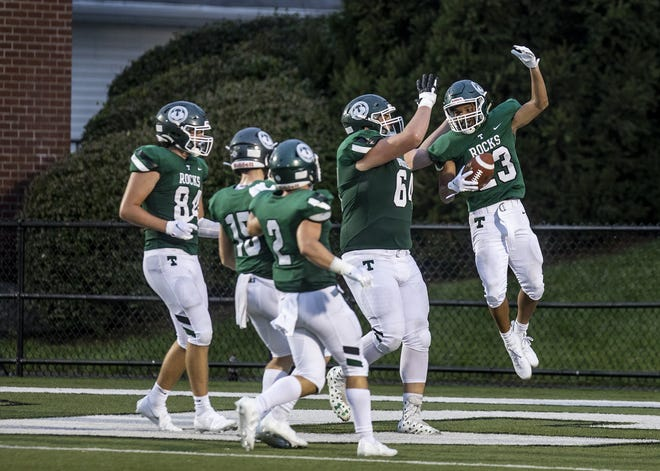 Trinity running back Armon Tucker (23) celebrated with his teammates in the endzone after scampering for a long touchdown long run as the Shamrocks cruised to victory over the visiting Cincinnati Moeller Crusaders 44-7 Friday night at Marshall Stadium. Sept. 11, 2020