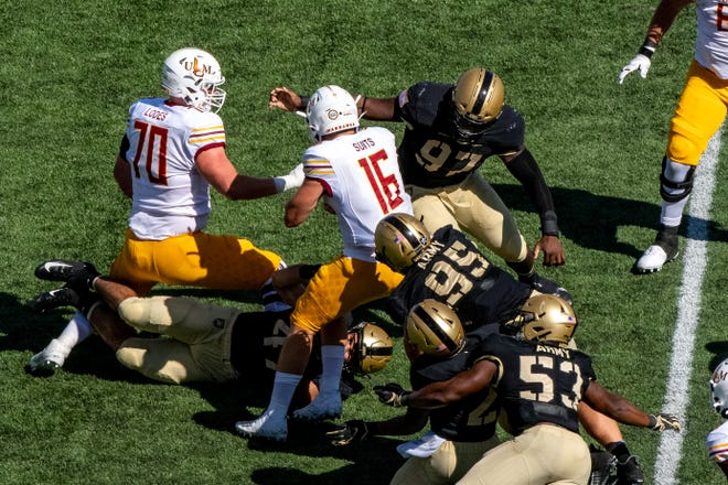 ULM Warhawks quarterback Colby Suits (16) is sacked during the second quarter by Army Black Knights defensive lineman Kwabena Bonsu (97) at Michie Stadium. Mandatory Credit: John Jones-USA TODAY Sports