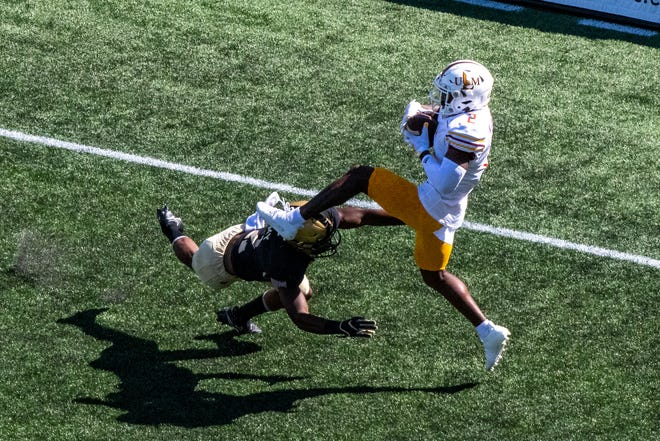 Malik Jackson (2) catches a touchdown pass over Army Black Knights defensive back Malkelm Morrison (2) during the second quarter at Michie Stadium. The score porduced ULM's only points of the 37-7 loss.