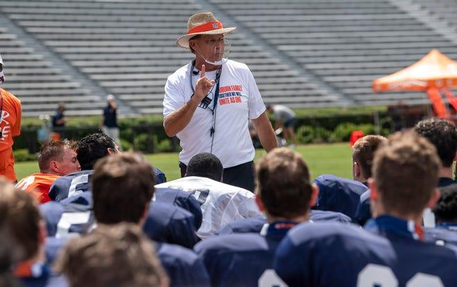 Auburn coach Gus Malzahn talks to his team after practice Saturday, Sept. 12, 2020 in Auburn, Ala.