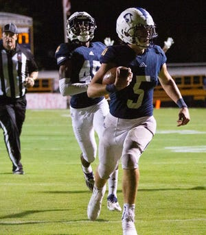 St. James' Cosner Harrison (5) runs the ball in for a touchdown early in the second half against Bullock County.