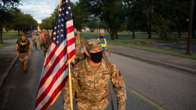 Chief Master Sgt. Michael Morgan, 42nd Air Base Wing command chief, leads Airmen on a ruck march in remembrance of 9/11, Sept. 11, 2020, on Maxwell Air Force Base, Alabama. The ruck march was 2.72 miles and included multiple stops around base.