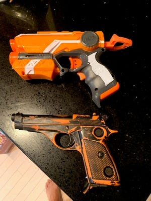 Toy guns parent said were seen by a teacher during a class's Zoom session.