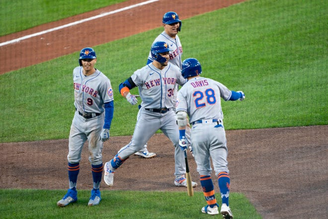 Sep 11, 2020; Buffalo, New York, USA; New York Mets third baseman J.D. Davis (28) congratulates Mets right fielder Michael Conforto (30) on hitting a three run home run along with Mets center fielder Brandon Nimmo (9) and Mets catcher Wilson Ramos (40) during the third inning against the Toronto Blue Jays  at Sahlen Field. Mandatory Credit: Gregory Fisher-USA TODAY Sports