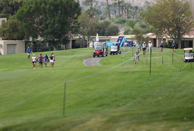 The group of Nelly Korda, Lexi Thompson and Mirim Lee walk toward their tee shots on the fourth hole of the ANA Inspiration, September 12, 2020. Volunteers and media made up most of the gallery during the LPGA major championship at Mission Hills Country Club in Rancho Mirage.