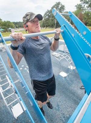 Air Force veteran Glenn Parker works out at the Fitness Court in Bayview Park in Pensacola on Friday, Sept. 11, 2020.