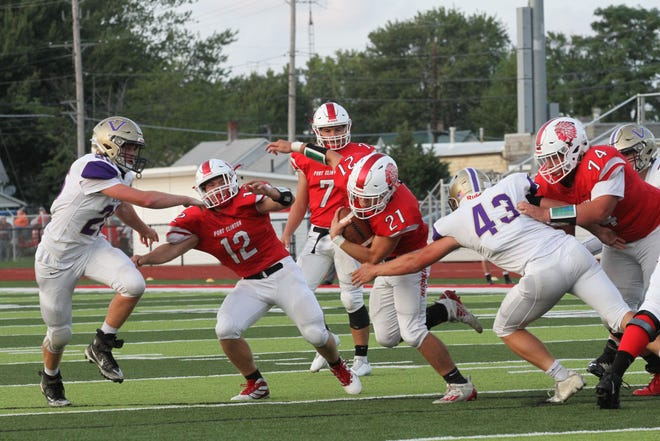 Port Clinton's Westin Laird tries to avoid a defender.