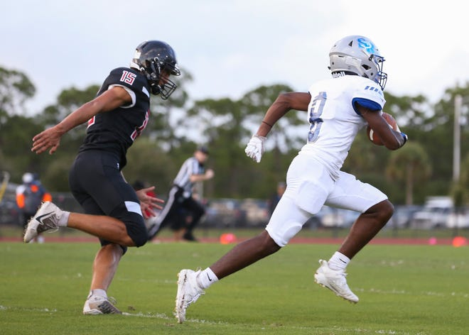 Sebastian River's Terrel Hodges gains yardage for a first down against South Fork in the first quarter of a high school football game at South Fork High School on Friday Sept. 11, 2020 in Stuart.