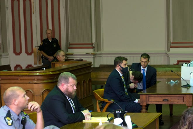 Lucas Collins covers his face and cries when he hears Judge Mark Fleegle say the jury found him not guilty.