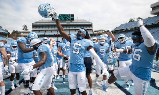 North Carolina's Dazz Newsome (5) and his teammates celebrate their 31-6 victory over Syracuse at Kenan Stadium in Chapel Hill, N.C.