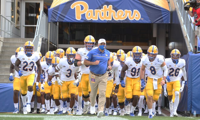 Pittsburgh Panthers head coach Pat Narduzzi (middle) leads his team onto the field to play the Austin Peay Governors.