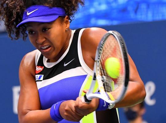 Naomi Osaka rallied to beat Victoria Azarenka in three sets for her third Grand Slam title.