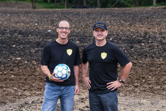Bob Ritchie, travel director, and Brian Simeone, president of the Alliance Community Soccer Club, stand in the area where the club plans to build nine soccer fields on which teams will play beginning in fall 2021.  (CantonRep.com / Ray Stewart)