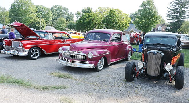 Vehicles of all shapes, sizes and colors fill the land around the historic Armory in Ashland during Saturday's Rebel Rousers Rumble car show.