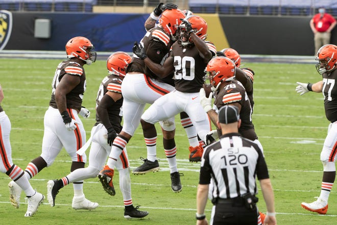 Cleveland Browns defensive end Myles Garrett (95) celebrates with cornerback Tavierre Thomas (20) after recovering a fumble during the second quarter against the Baltimore Ravens at M&T Bank Stadium on Sept. 13.