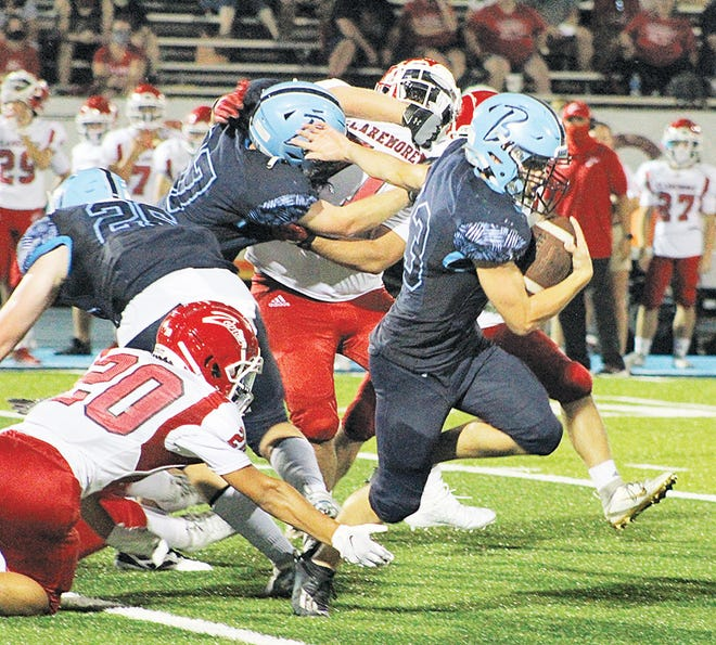 Bartlesville High School runningback Dylan McCoy, right, breaks free during varsity football action earlier this season. McCoy rushed for more than 100 yards during last Friday's battle at Sapulpa.