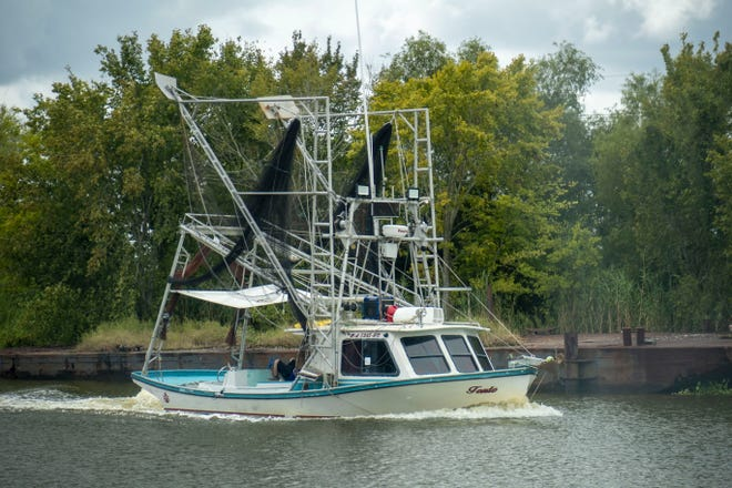 A shrimp boat heads north through Bayou Terrebonne in Montegut as Tropical Storm Sally threatened Sept. 13.