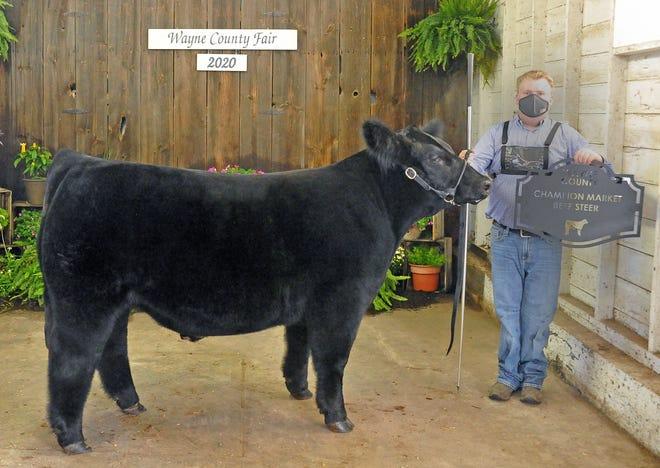 Cole Wharton showed the champion overall market beef steer and the champion market beef steer.