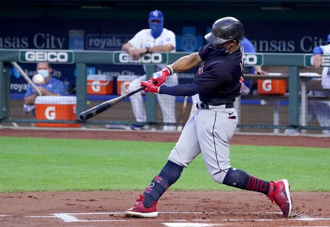Cleveland Indians shortstop Francisco Lindor (12) connects for a two-run home run in the first inning against the Kansas City Royals at Kauffman Stadium on Sept. 1.