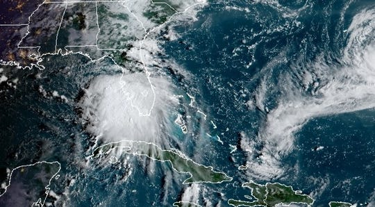 Tropical Storm Sally is seen in a satellite image Sunday morning, Sept. 13.