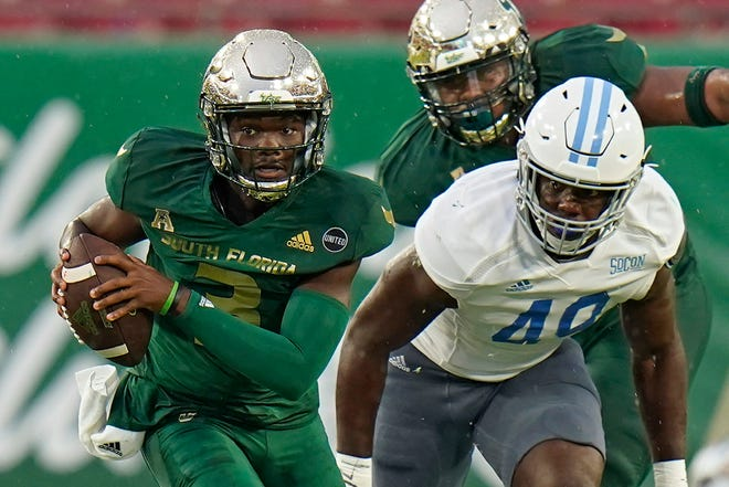 South Florida quarterback Jordan McCloud (3) breaks away from Citadel linebacker Marquise Blount (49) during the first half of an NCAA game Saturday in Tampa.
