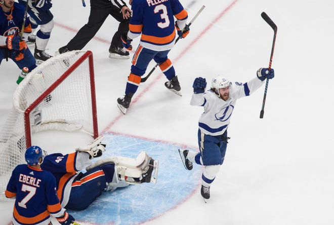 Tampa Bay Lightning's Brayden Point (21) celebrates his goal against New York Islanders goalie Semyon Varlamov (40) during the third period of an NHL Eastern Conference final playoff game in Edmonton, Alberta, on Sunday.