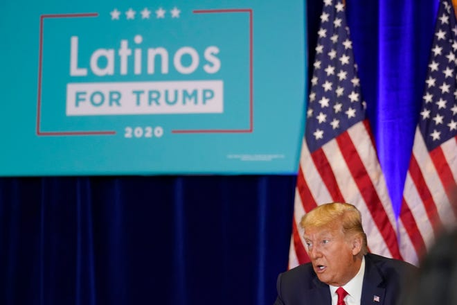 President Donald Trump participates in a Latinos for Trump Coalition roundtable at Treasure Island Hotel & Casino on Sunday in Las Vegas.