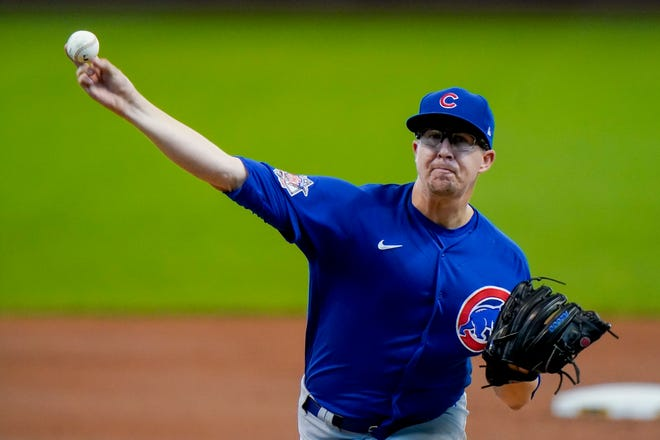 Chicago Cubs starting pitcher Alec Mills throws during the first inning against the Milwaukee Brewers on Sunday in Milwaukee.