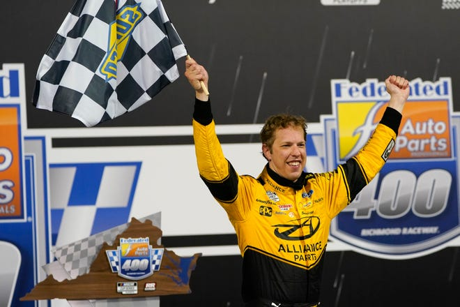 Brad Keselowski (2) celebrates in Victory Lane after winning a NASCAR Cup Series auto race Saturday in Richmond, Va.