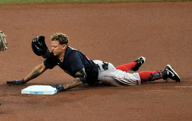 Boston Red Sox's Yairo Munoz slides into second base with a double off Tampa Bay Rays starter Charlie Morton during the first inning Sunday in St. Petersburg.