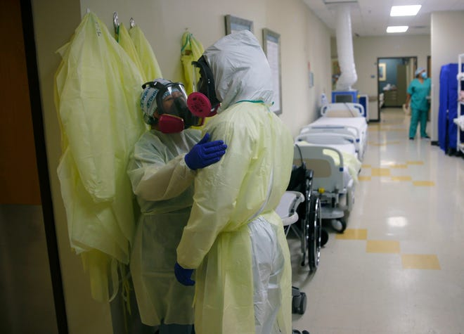 Medical personnel talk in July as they care for COVID-19 patients at DHR Health in McAllen, Texas.