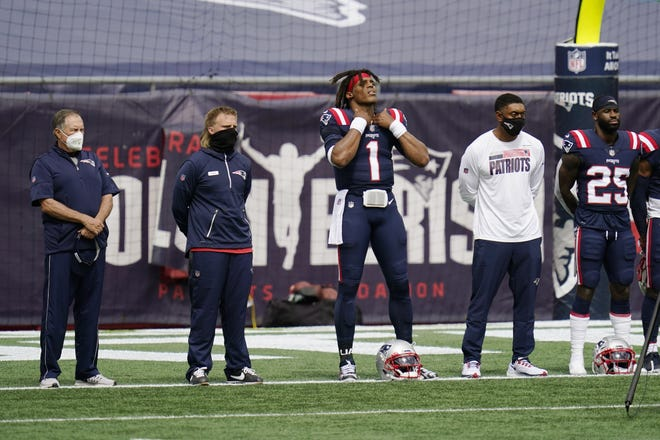 "New England Patriots including coach Bill Belichick, left, quarterback Cam Newton (1) and defensive back Terrence Brooks (25) stand during the singing of ""Lift Every Voice and Sing."" (AP Photo/Charles Krupa)"